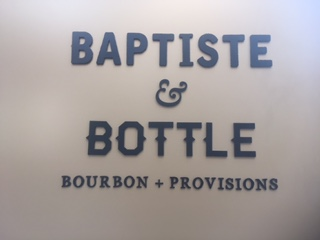 Baptiste and Bottle Sign the Lowdown
