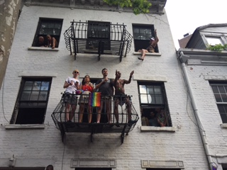 NYC Pride Parade people watching from building 2018